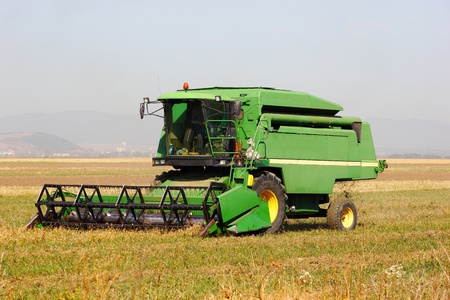 old big green wheat harvester
