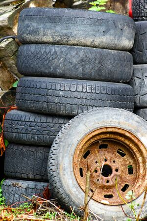 abandoned car tyres in the nature