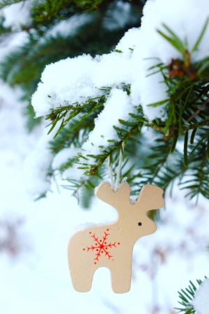 small wooden deer in winter photo