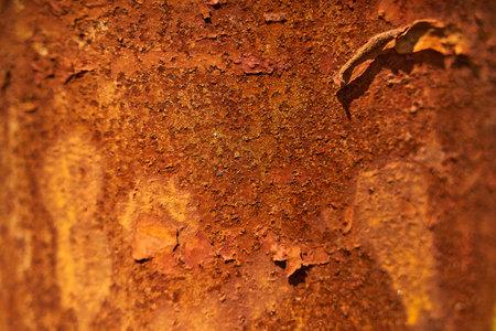 Rust on a pillar closeup. Rust texture