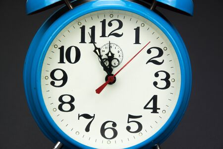 analogous: Alarm clock five minutes to twelve
