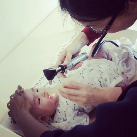 up: Doctor doing medical check up for a baby Stock Photo