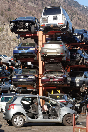 Valais, Switzerland, 21.02.2019, Recycling of old,used, wrecked cars. Dismantling for parts at scrap yards and sending for remelting