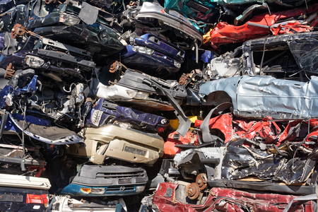 Valais, Switzerland, 26.02.2019, Recycling of old,used, wrecked cars. Dismantling for parts at scrap yards and sending for remelting Редакционное