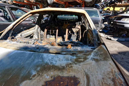 Valais, Switzerland, 26.02.2019, Recycling of old,used, wrecked cars. Dismantling for parts at scrap yards and sending for remelting Redakční