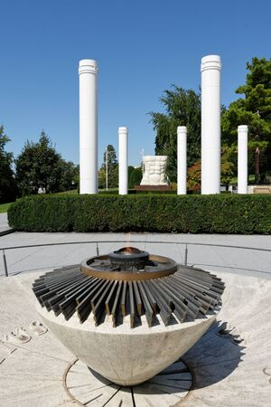Lausanne, Switzerland, 08.16.2019, Olympic Museum of Lausanne, park and garden, general entrance and these columns, Olympic flame