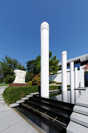 Lausanne, Switzerland, 08.16.2019, Olympic Museum of Lausanne, park and garden, general entrance and these columns