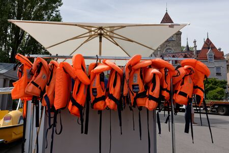 Lausanne, Vaud, Swizerland; 03.09.2019, Stock of life jackets for water sports