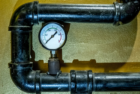 The photo of the established metal pipes for water supply with pressure sensors