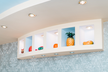 The photo of the decorative shelf in kitchen with fruit