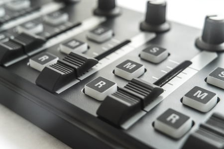 Photo of the analog audio mixer of the sound producer close up 스톡 콘텐츠