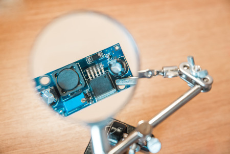 The photo of the electric circuit because of magnifying glass close up