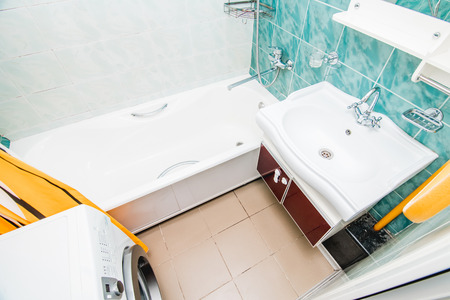 The photo of the light white bathroom with household appliances the top view Banco de Imagens