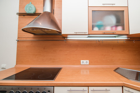 The photo of completely equipped light kitchen with household appliances Imagens