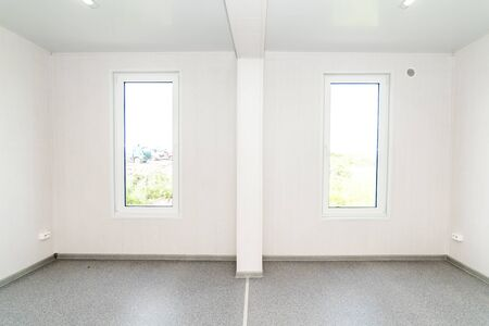 The photo of light white empty office room with bright lighting