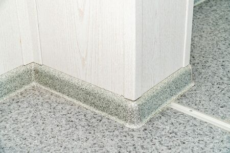 The photo of a plastic plinth on a floor close up