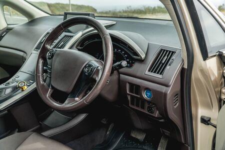 The bright photo of the dashboard in the car with black salon Archivio Fotografico - 131852051