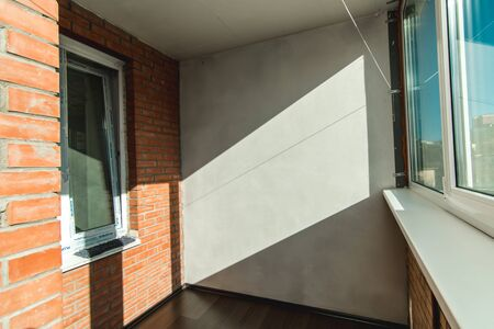 The photo of a light balcony with a view from the window