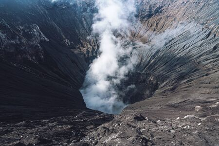 Photo of smoke volcano crater on Java island in Indonesia