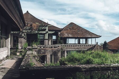 Dark photo of abandoned building with dirty walls and broken roof