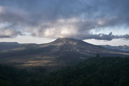 Photo of high volcano with clouds on Bali island in Indonesia