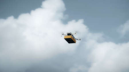 Photo of a flying on a sky delivery drone with holding a cardboard parcel Stock Photo
