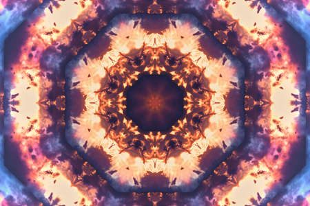 Abstract background from a repeating kaleidoscope view with yellow and blue dark and bright lines and shapes coming from the center Banco de Imagens