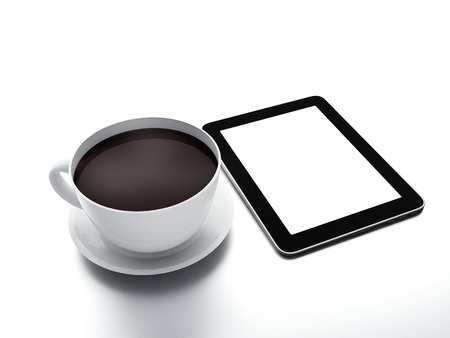 Coffee cup with tablet pc on white isolated background. photo