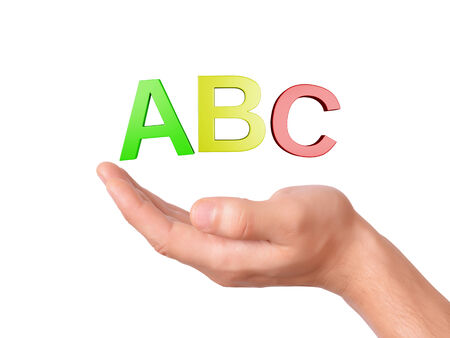 hand holding letters ABC symbol on white Background photo