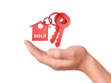 hand Holding house keys. sold concept  on white background photo