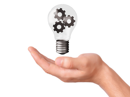 hand hold light bulb with gears. business concepton white background photo