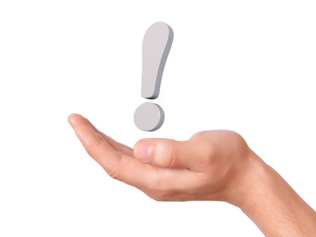 interjection: hand hold exclamation mark on white background Stock Photo
