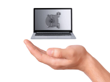 hand holding security Laptop. Data security concept on white background photo