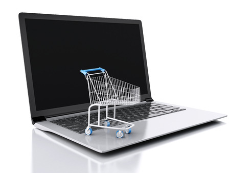 3d Shopping cart and laptop. Online shopping concept. isolated white background photo