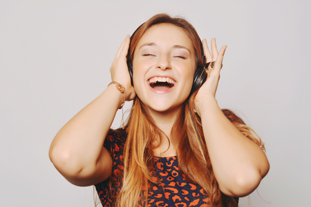 Beautiful young girl with headphones listening music photo