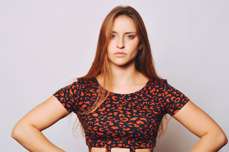 beautiful businesswoman: Closeup of young beautiful woman with worried expression