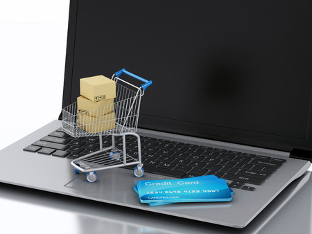 3d image.  Laptop with Shopping cart and credit cards.  Online shopping concept.