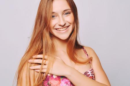 teen girl bikini: Portrait of a young woman posing in swimsuit.