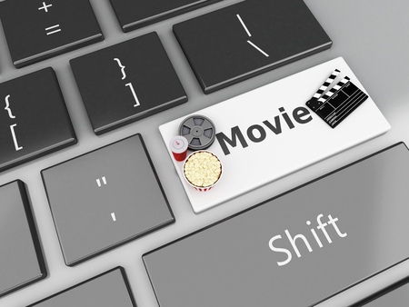 cinematography: 3d illustration. Cinema Clapper board, popcorn and Film reel on computer keyboard. Cinematography concept. Stock Photo