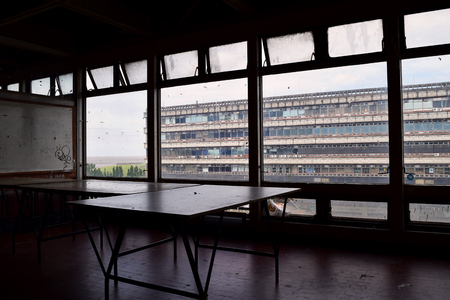 interior desing: Empty art studio with an old building in the background.