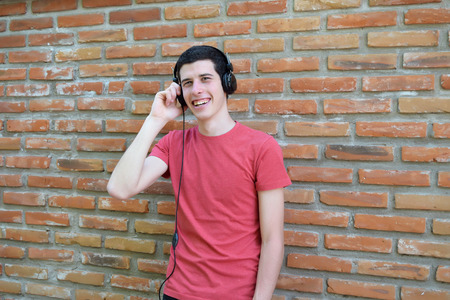 cool guy: Young latin man with black headphones. Trendy and urban style.
