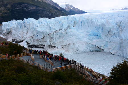 proficient: People looking at the Perito Moreno Glacier in the Patagonia Argentina. Stock Photo