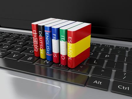 computer language: 3d illustration. Dictionaries on computer keyboard. E-learning. Languages learn and translate, education concept.