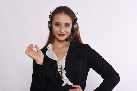 telemarketer: Portrait of beautiful telemarketer woman. Isolated white background. Stock Photo