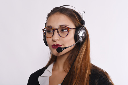 telemarketer: Close up of beautiful telemarketer woman. Isolated white background. Stock Photo