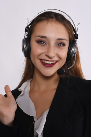 handsfree phone: Close up of beautiful telemarketer woman. Isolated white background. Stock Photo