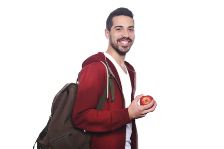 bookbag: Portrait of young latin student with an apple and backpack. Isolated white background.