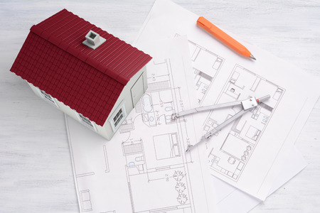 house plan: A house with house plan and tools. Architecture Concept.