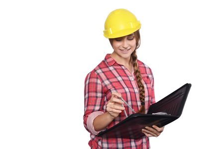 industry background: Portrait of beautiful woman construction worker with a compass and a folder. Isolated white background.