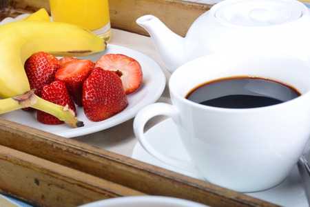 comfort food: Breakfast tray with coffee and fresh fruits. Stock Photo